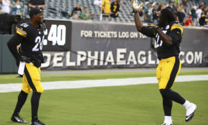 PHILADELPHIA, PA - AUGUST 21: Running backs Le'Veon Bell #26 and LeGarrette Blount #27 of the Pittsburgh Steelers warm up prior to the game against the Philadelphia Eagles on August 21, 2014 at Lincoln Financial Field in Philadelphia, Pennsylvania. (Photo by Al Bello/Getty Images)