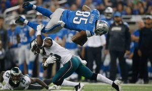 DETROIT, MI - NOVEMBER 26: Eric Ebron #85 of the Detroit Lions is tackled by Walter Thurmond #26 of the Philadelphia Eagles after a second quarter reception at Ford Field on November 26, 2015 in Detroit, Michigan. (Photo by Gregory Shamus/Getty Images)