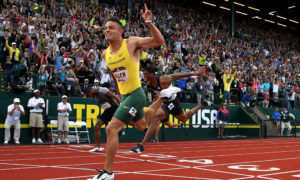 EUGENE, OR - JULY 09: Devon Allen, first place, crosses the finish line to win the Men's 110 Meter Hurdles Final during the 2016 U.S. Olympic Track & Field Team Trials at Hayward Field on July 9, 2016 in Eugene, Oregon.