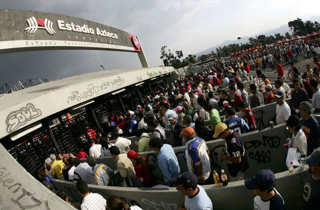 MEXICO CITY - OCTOBER 02:  Mexican spectators enter the stadium turnstiles before the NFL game between the San Francisco 49ers and the Arizona Cardinals on October 2, 2005 at Estadio Azteca in Mexico City, Mexico.  (Photo by Robert Laberge/Getty Images)