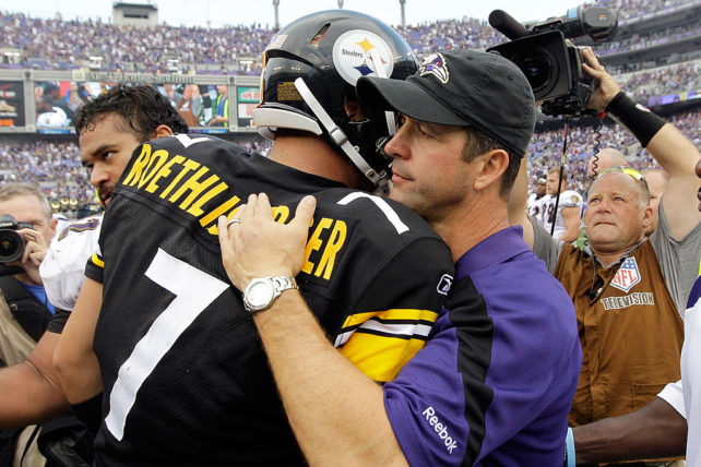 BALTIMORE, MD - SEPTEMBER 11: Head coach John Harbaugh of the Baltimore Ravens (R) talks with quarterback Ben Roethlisberger #7 of the Pittsburgh Steelers following the Ravens 35-7 win during the season opener at M&T Bank Stadium on September 11, 2011 in Baltimore, Maryland. (Photo by Rob Carr/Getty Images)