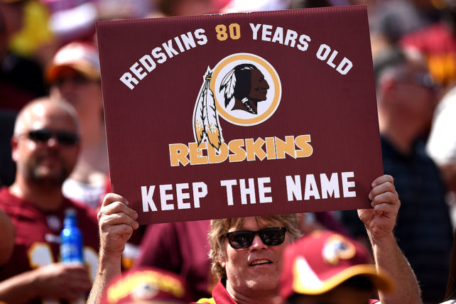 LANDOVER, MD - SEPTEMBER 14: A Washington Redskins fan holds up a sign to keep the Redskins name before they play the Jacksonville Jaguars at FedExField on September 14, 2014 in Landover, Maryland. The Washington Redskins won, 41-10. (Photo by Patrick Smith/Getty Images)
