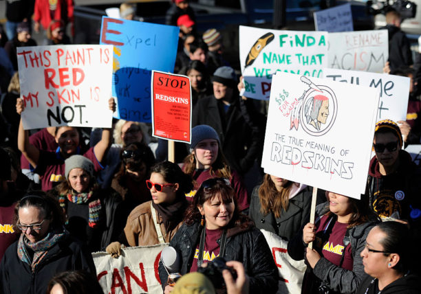 MINNEAPOLIS, MN - NOVEMBER 2: People march to TCF Bank Stadium to protest against the mascot for the Washington Redskins before the game against the Minnesota Vikings on November 2, 2014 in Minneapolis, Minnesota. Opponents of the Redskins name believe it's a slur that mocks Native American culture and they want the team to change it. (Photo by Hannah Foslien/Getty Images)