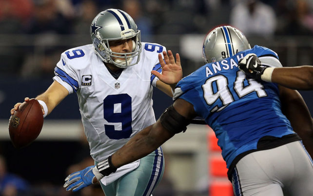 ARLINGTON, TX - JANUARY 04: Tony Romo #9 of the Dallas Cowboys tries to avoid the pressure by Ezekiel Ansah #94 of the Detroit Lions during the second half of their NFC Wild Card Playoff game at AT&T Stadium on January 4, 2015 in Arlington, Texas. (Photo by Sarah Glenn/Getty Images)
