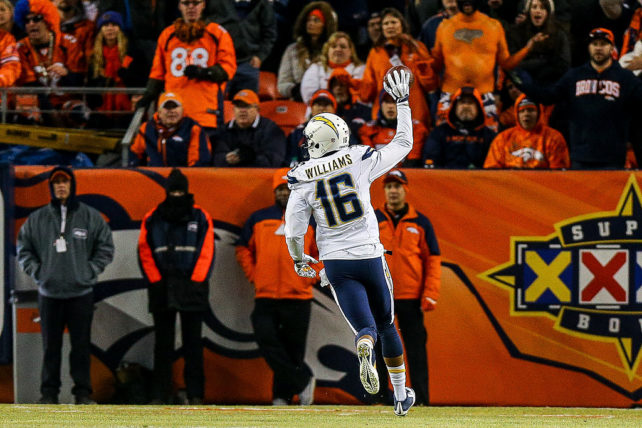 DENVER, CO - JANUARY 3:  Wide receiver Tyrell Williams #16 of the San Diego Chargers begins to celebrate after catching a pass for an 80-yard touchdown against the Denver Broncos in the fourth quarter of a game at Sports Authority Field at Mile High on January 3, 2016 in Denver, Colorado. The catch was the first of Williams' NFL career. (Photo by Justin Edmonds/Getty Images)