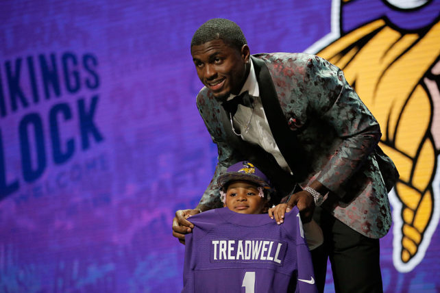 CHICAGO, IL - APRIL 28: Laquon Treadwell of Ole Miss holds up a jersey with his daughter Madison after being picked #23 overall by the Minnesota Vikings during the first round of the 2016 NFL Draft at the Auditorium Theatre of Roosevelt University on April 28, 2016 in Chicago, Illinois. (Photo by Jon Durr/Getty Images)