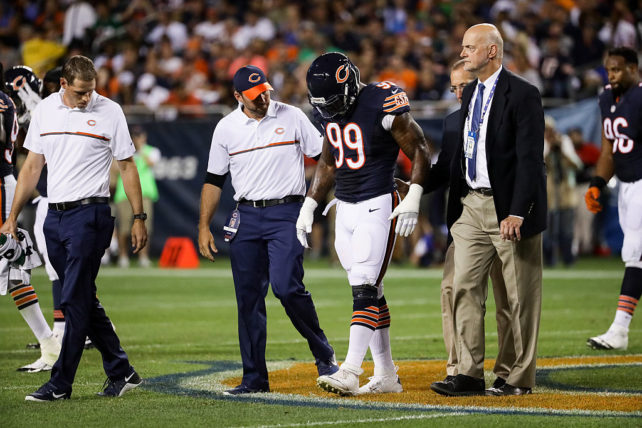 CHICAGO, IL - SEPTEMBER 19: Lamarr Houston #99 of the Chicago Bears leaves the game with a knee injury in the first half against the Philadelphia Eagles at Soldier Field on September 19, 2016 in Chicago, Illinois. (Photo by Jonathan Daniel/Getty Images)