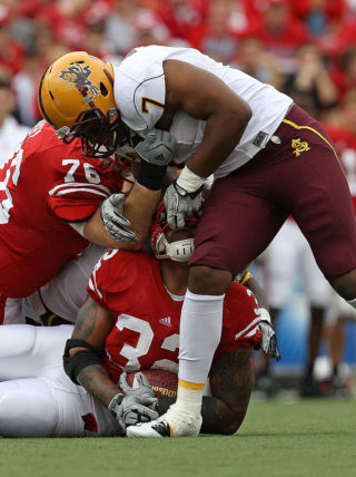 MADISON, WI - SEPTEMBER 18: John Clay #32 of the Wisconsin Badgers is tackled by the fask mask by Vontaze Burfict #7 of the Arizona State Sun Devils at Camp Randall Stadium on September 18, 2010 in Madison, Wisconsin. (Photo by Jonathan Daniel/Getty Images)