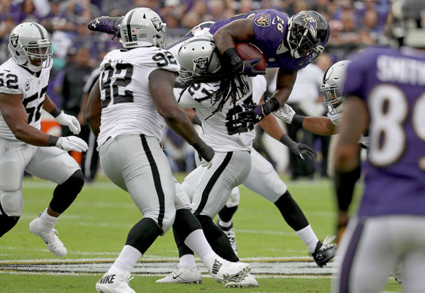 BALTIMORE, MD - OCTOBER 2: Reggie Nelson #27 of the Oakland Raiders tackles Terrance West #28 of the Baltimore Ravens in the first quarter at M&T Bank Stadium on October 2, 2016 in Baltimore, Maryland. (Photo by Rob Carr/Getty Images)
