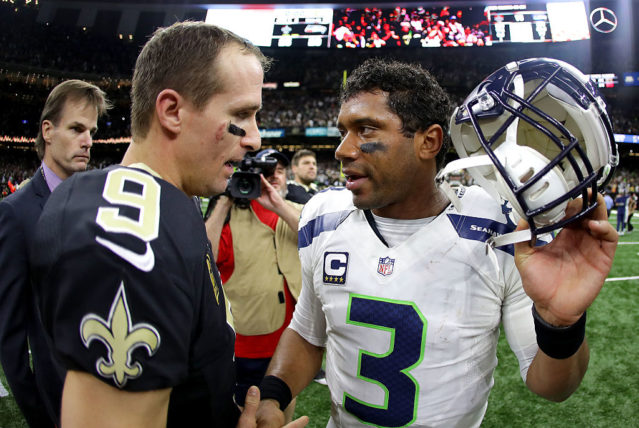 NEW ORLEANS, LA - OCTOBER 30: Drew Brees #9 of the New Orleans Saints is congratulated by Russell Wilson #3 of the Seattle Seahawks after their game at the Mercedes-Benz Superdome on October 30, 2016 in New Orleans, Louisiana. New Orleans won the game 25-20. (Photo by Sean Gardner/Getty Images)