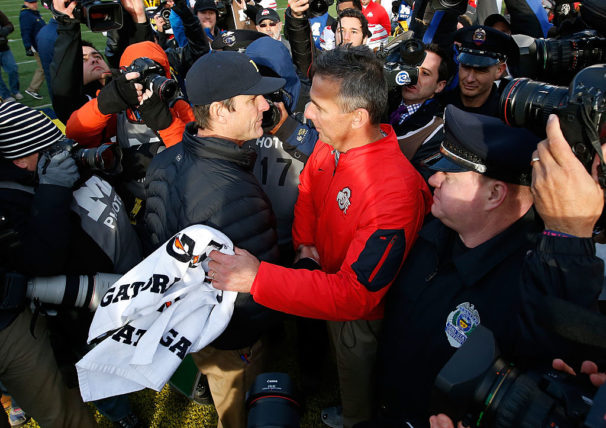 ANN ARBOR, MI - NOVEMBER 28: Head coach Urban Meyer of the Ohio State Buckeyes shakes hands with head coach Jim Harbaugh of the Michigan Wolverines after a 42-13 Ohio State win at Michigan Stadium on November 28, 2015 in Ann Arbor, Michigan. (Photo by Gregory Shamus/Getty Images)