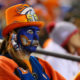 DENVER, CO - NOVEMBER 27:  A Denver Broncos fan watches the third quarter of the game against the Kansas City Chiefs at Sports Authority Field at Mile High on November 27, 2016 in Denver, Colorado. (Photo by Justin Edmonds/Getty Images)