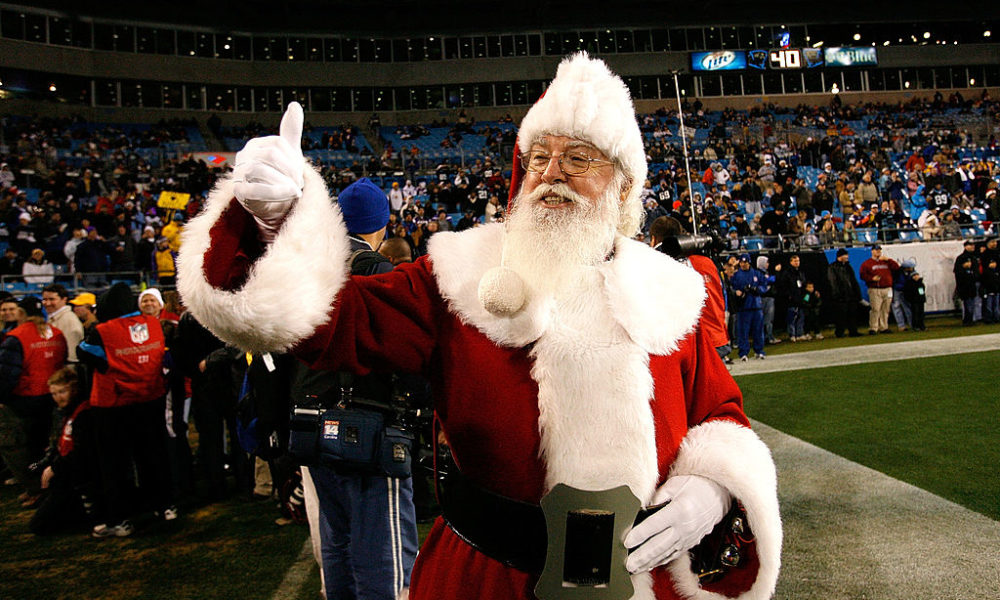 CHARLOTTE, NC - DECEMBER 20:  Santa Claus walks onto the field before the game against the Minnesota Vikings and the Carolina Panthers at Bank of America Stadium on December 20, 2009 in Charlotte, North Carolina.  (Photo by Kevin C. Cox/Getty Images)