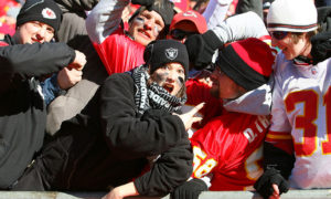 KANSAS CITY, MO - JANUARY 02:  Kansas City Chiefs fans heckle an Oakland Raiders fan during a game at Arrowhead Stadium on January 2, 2011 in Kansas City, Missouri.  (Photo by Tim Umphrey/Getty Images)