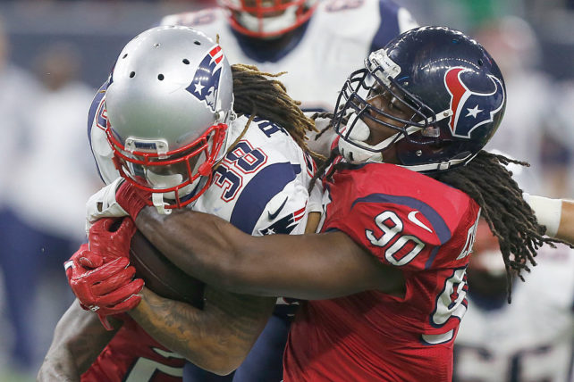 HOUSTON, TX - DECEMBER 13: Brandon Bolden #38 of the New England Patriots is tackled by Jadeveon Clowney #90 of the Houston Texans in the second quarter on December 13, 2015 at NRG Stadium in Houston, Texas. (Photo by Bob Levey/Getty Images)