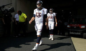 CINCINNATI, OH - SEPTEMBER 25:  Trevor Siemian #13 of the Denver Broncos and Paxton Lynch #12 of the Denver Broncos walk out to the field prior to the start of the game against the Cincinnati Bengals at Paul Brown Stadium on September 25, 2016 in Cincinnati, Ohio. (Photo by John Grieshop/Getty Images)
