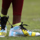LANDOVER, MD - OCTOBER 2: Wide receiver DeSean Jackson #11 of the Washington Redskins wears cleats displaying police caution tape prior to a game against the Cleveland Browns at FedExField on October 2, 2016 in Landover, Maryland. (Photo by Patrick Smith/Getty Images)