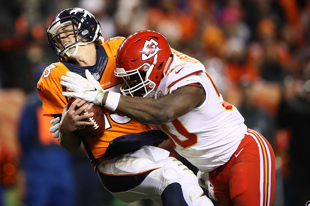 DENVER, CO - NOVEMBER 27:  Outside linebacker Justin Houston #50 of the Kansas City Chiefs sacks quarterback Trevor Siemian #13 of the Denver Broncos for a safety in the second quarter of the game at Sports Authority Field at Mile High on November 27, 2016 in Denver, Colorado. (Photo by Ezra Shaw/Getty Images)